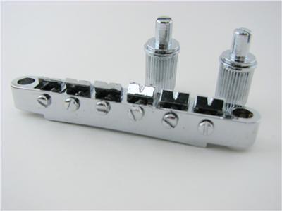 electric-guitar-chrome-tune-o-matic-bridge.jpg